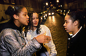 Teenage girls talk in the street in London.