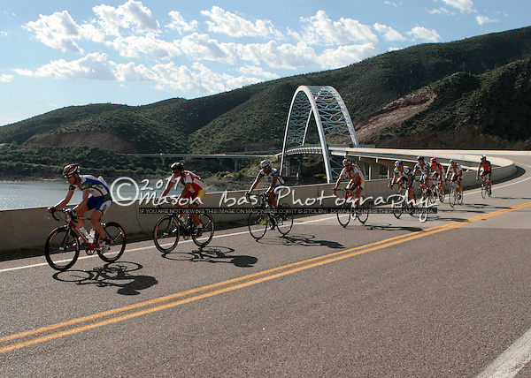 The peloton crosses the Roosevelt Lake Bridge during the Globe Omnium. The Bidge is the longest two-lane, single-span, steel-arch bridge in North America, and was named one of the top 12 Bridges in America in 1995.