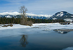 Idaho. Winter view of Clark Fork river and mountains near the town of Clark Fork.