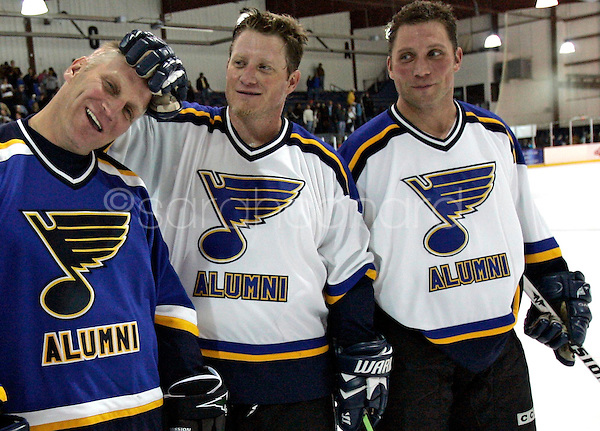 (Sunday, December 03, 2006)-Bobby Hull, center, teases his brother, Brett Hull, as their other brother, Bart Hull, right, looks on, after the St. Louis Blues Alumni Hockey Game at the Summit Center in Chesterfield. The Hull brothers all wore #16 in honor of the retirement of Brett Hull's number.