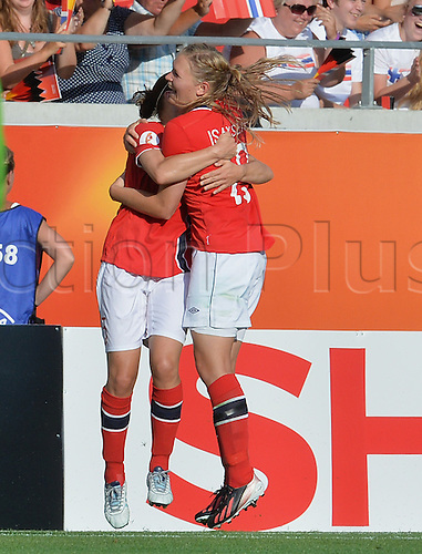 17.07.2013. Kalmar, Sweden.  Ingvild Isaksen (r) from Norway celebrates after scoring the goal for 1-0 with Maren Mjelde during the UEFA Women's EURO 2013 Group B soccer match between Germany and Norway at the Kalmar Arena in Kalmar, Sweden, 17 July 2013.