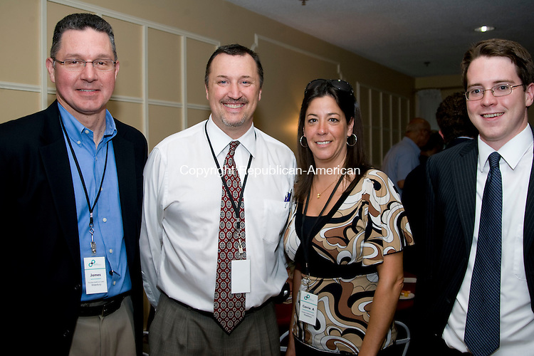 WATERBURY, CT - 27 JULY 2009 -072709JT19-<br /> From left, James Christofori, David Stevens and Carrie Allen of Paradign Health Care Center with Patrick Skelly of Whitecap Technologies during a midsummer networking, art show and performance event put on by the Arts &amp; Culture Collaborative of the Waterbury Region and the Village at East Farms on Thursday, July 23 at the Lodge at Village at East Farms in Waterbury. Work by local artists and photographers Vicki Bouffard, East Farms residents, Georgia Sheron and Tina Petta-Pelletier were featured. Performers included Brass City Ballet, Kiva Dance Collective, Main Street Ballet and singer Cristin Mortenson and A. J. Jansen.<br /> Josalee Thrift Republican-American