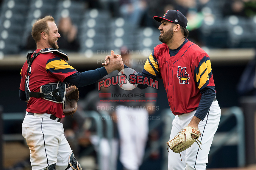 Toledo Mud Hens catcher Bryan Holaday (6) congratulates pitcher Arcenio Leon (34) after defeating the Lehigh Valley IronPigs during the International League baseball game on April 30, 2017 at Fifth Third Field in Toledo, Ohio. Toledo defeated Lehigh Valley 6-4. (Andrew Woolley/Four Seam Images)