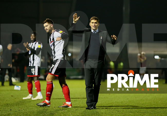 Harry Cardwell of Grimsby Town and Grimsby Town Manager Michael Jolley celebrate to the fans after during the Sky Bet League 2 match between Northampton Town and Grimsby Town at Sixfields Stadium, Northampton, England on 24 November 2018. Photo by Leila Coker / PRiME Media Images.