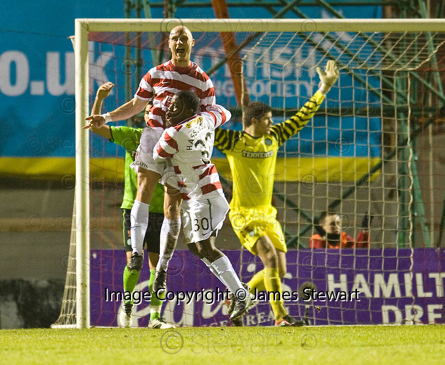 12/01/2011   Copyright  Pic : James Stewart.sct_jsp003_hamilton_v_celtic  .::  SIMON MENSING CELEBRATES AFTER HE SCORES HAMILTON'S FIRST GOAL  ::.James Stewart Photography 19 Carronlea Drive, Falkirk. FK2 8DN      Vat Reg No. 607 6932 25.Telephone      : +44 (0)1324 570291 .Mobile              : +44 (0)7721 416997.E-mail  :  jim@jspa.co.uk.If you require further information then contact Jim Stewart on any of the numbers above.........
