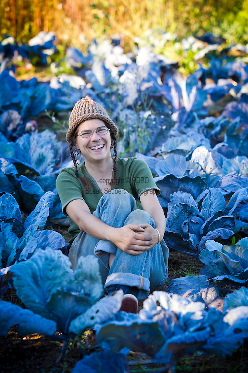 "The Southeast Urban Agricultural Cooperative, formerly known as the Sellwood Garden Club, working at one of their 5many garden plots throughout the city of Portland.  Pictured here is Friday Purington at the ""Allister Plot"" which is one of 55 gardens in the Portland Metro area that their organization oversees."