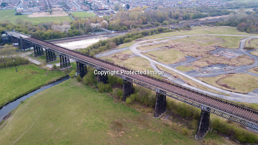 09/04/19<br /> <br /> Almost half-a-million pounds of funding has been secured to transform one of only two remaining wrought-iron trestle viaducts in England. The Bennerley Viaduct closed in 1968 and was earmarked for demolition but its iron construction made it expensive to dismantle. <br /> <br /> Work to renew the wooden decking and create a footpath and cycle path will take 18 months. The viaduct is a grade II listed structure dating from 1877  spanning the Erewash Valley for 440 meters (approximately 1/4 mile) between Cotmanhay in Derbyshire and Awsworth in Nottinghamshire. <br /> <br /> The viaduct deck is some 18 metres (60 feet) above the River Erewash.  <br /> <br /> All Rights Reserved, F Stop Press Ltd.  (0)7765 242650  www.fstoppress.com rod@fstoppress.com