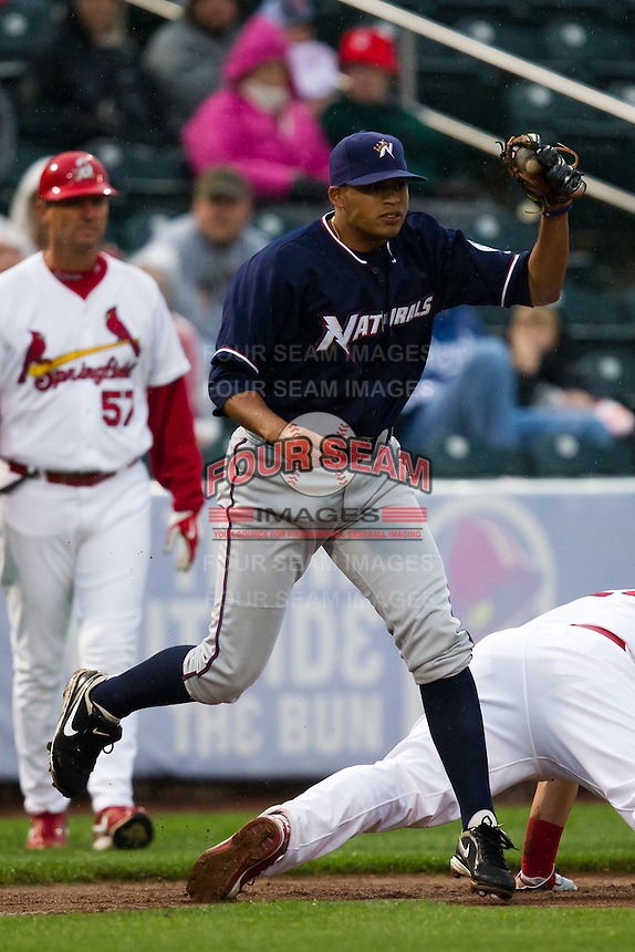 Mario Lisson (29) of the Northwest Arkansas Naturals tags out Matthew Adams (25) of the Springfield Cardinals at third base during a game against the Springfield Cardinals on May 13, 2011 at Hammons Field in Springfield, Missouri.  Photo By David Welker/Four Seam Images.