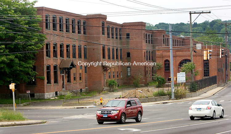 WATERBURY CT. 11 June 2015-061115SV04-Meridian Atlantic Properties of Cheshire is knocking down an old factory at the corner of Huntington and Thomaston avenues with plans to build a Cumberland Farms store and gas station and retail building of some sort at that site.<br /> Steven Valenti Republican-American