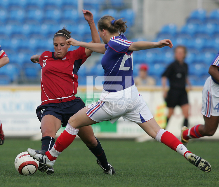 MAR 13, 2006: Faro, Portugal:  USWNT midfielder (11) Carli Lloyd tries to take possession away from  France defender (20) Laure Lepailleur in the Algarve Cup in Faro Portugal.