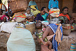"FEBRUARY 12 & 13, 2009 : BONDAS, GADABAS , TRIBALS COME FROM THE HILLS FOR THE THURSDAY MARKET IN ONUKUDELLI, SOUTH OF JEYPORE IN WESTERN ORISSA. THIS IS PART OF INDIA'S TRIBAL BELT. THE BONDA  OR BONDO ARE AN ANCIENT TRIBE OF PEOPLE NUMBERING APPROX 5000 WHO LIVE IN THE ISOLATED HILL REGION OF SOUTHWEST ORISSA, THE BONDA ARE A SCHEDULED TRIBE IN INDIA AND ARE ALSO KNOWN AS REMO (MEANING ""PEOPLE"" IN BONDA LANGUAGE). THE TRIBE IS THE OLDEST AND MOST PRIMITIVE IN MAINLAND INDIA AND THEIR CULTURE HAS LITTLE CHANGED IN OVER THOUSAND YEARS. THEIR ISOLATION AND AGGRESSION PRESERVED THEIR CULTURE DESPITE THE PRESSURE OF AN EXPENDING INDIAN POPULATION. WOMEN WEAR THICK SILVER NECKLACE BANDS AND LONG COLORFUL NECKLACES MADE OF BEADS."