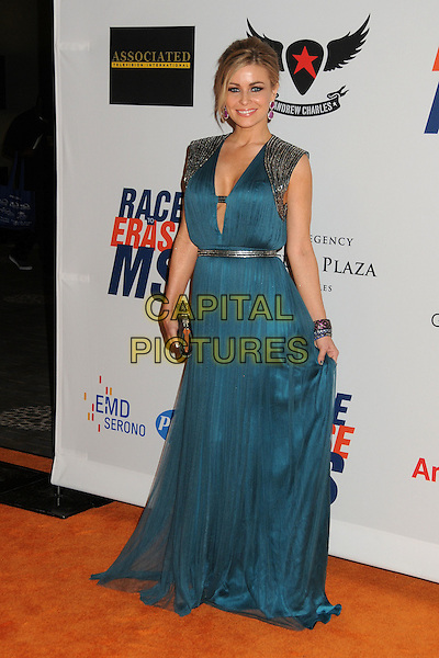 Carmen Electra.19th Annual Race To Erase MS held at the Hyatt Regency Century Plaza Hotel, Century City, California, USA, .18th May 2012..full length blue teal make-up purple pink earrings silver shoulders cleavage dress cut out long maxi clutch bag bracelet belt .CAP/ADM/BP.©Byron Purvis/AdMedia/Capital Pictures.