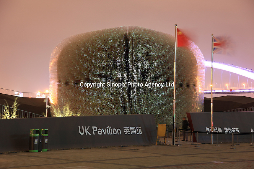 "The UK Pavillion at the 2010 Expo site in Shanghai, China. Developed by one of the UK's leading creative talents, Thomas Heatherwick, the centrepiece of the UK pavilion is a six storey high object formed from some 60,000 slender transparent rods, which extend from the structure and quiver in the breeze. During the day, each of the 7.5m long rods act like fibre-optic filaments, drawing on daylight to illuminate the interior, thereby creating a contemplative awe-inspiring space. At night, light sources at the interior end of each rod allow the whole structure to glow. The Theme of the UK Pavilion is ""Building on the Past, Shaping our Future"".."