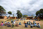 In Mchingi district, one of the areas where the scheme is being piloted, family members gather for the cash disbursements, which are given once a month. Only the poorest families receive money &ndash; those where no one can work because all the adults have died or are sick or disabled &ndash; and a small bonus is paid if children are in school.<br />