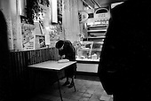 Moscow, Russia  .1998.81-year-old Anna Ivanovna checks her small change to see if she can afford a second loaf of bread. She is one of many pensioners struggling to get by in Russia on a daily basis as the government owes them 20 billion rubles in back pay..