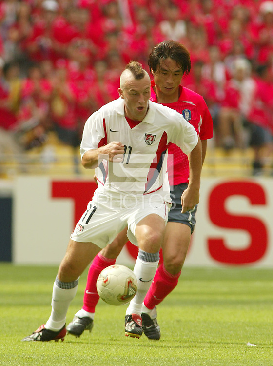 Clint Mathis controls the ball. The USA tied South Korea, 1-1, during the FIFA World Cup 2002 in Daegu, Korea.