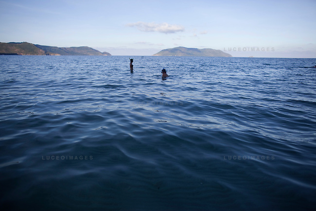 Phung Bui-Singer, 34, left, and Julia Le, 35, of San Jose, Calif., snorkel at Bai Nhat beach on Con Son Island, part of the Con Dao Islands.The 16 mountainous islands and islets are situated about 143 miles southeast of Ho Chi Minh City in Vietnam, in the South China. Photo taken Thursday, May 5, 2010...Kevin German / LUCEO For the New York Times