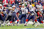 New England Patriotsquarterback Tom Brady (12) sets to pass against the Buffalo Bills at Ralph Wilson Stadium in Orchard Park, NY, on December 11, 2005 . The Patriots defeated the Bills 35-7. Mandatory Photo Credit: Ed Wolfstein