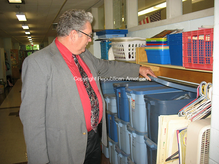 PROSPECT, CT - 24 September 2008 - 092408QL01 - William Stowelll, business manager of Region 16 school district, lifts the lid of some boxes in a hallway of the aging Algonquin School. The school, which was built in the 1950s, doesn't have enough space in classrooms for backpacks and other teaching tools so staff have to use the hallways. Quannah Leonard Republican-American