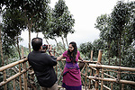tourists visit a view point all made by bamboo whew in a clear day,  they can see the border with bangladesh, Mawlynnong&nbsp;is a village in the&nbsp;East Khasi Hills district&nbsp;of the&nbsp;Meghalaya&nbsp;state, India.&nbsp;It is famous for its cleanliness and natural attraction. Mawlynnong was awarded the prestigious tag of 'Cleanest Village in Asia' in 2003 by Discover India Magazine.&nbsp;<br /> According the the census in 2015, the total population of Mawlynnong is 500 and&nbsp;is located 90&nbsp;km from&nbsp;Shillong, along the India-Bangladesh&nbsp;border.<br />