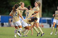 27 August 2011:  FIU's Nikki Rios (4), Sara Stewart (19) and others celebrate a goal by Kim Lopez (7) late in the first half as the University of Arkon Zips faced off against the FIU Golden Panthers at University Park Stadium in Miami, Florida.