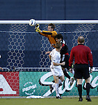 17 October 2004: Jonny Walker (top) outjumps Alecko Eskandarian (middle) and Chris Leitch to punch the ball away in the first half. DC United defeated the MetroStars 3-2 at RFK Stadium in Washington, DC during a regular season Major League Soccer game..