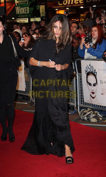 "MILA KUNIS.54th BFI London Film Festival Jameson Gala screening of ""Black Swan"" at the Vue West End, Leicester Square, London, England, UK,.October 22nd 2010..full length long maxi dress wrap shawl cardigan jacket walking open peep toe platform shoes black .CAP/ROS.©Steve Ross/Capital Pictures"