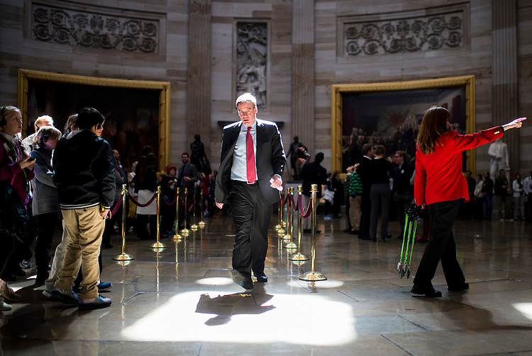UNITED STATES - MARCH 13: Sen. Mark Warner, D-Va., walks through the Rotunda from the House to the Senate side in the Capitol on Thursday, March 13, 2014. (Photo By Bill Clark/CQ Roll Call)