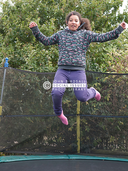 Girl on trampoline at playground