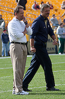 Pitt defensive coordinator Phil Bennett (left) and head coach Dave Wannstedt watch over players practicing before the game. The Pitt Panthers defeated the Louisville Cardinals 20-3 at Heinz Field, Pittsburgh Pennsylvania on October 30, 2010.