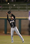 El Paso Chihuahuas' Alex Castellanos makes a play against the Reno Aces on opening day in Reno, Nev., on Thursday, April 3, 2014. <br /> Photo by Cathleen Allison