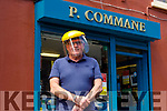 Pauidi Commane stands outside his shop in Rock Street