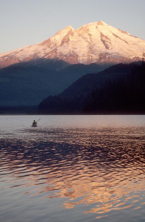 Kayaker, Mount Baker, Baker Lake, sunrise, Washington State, Cascade Mountains, Pacific Northwest, USA,..