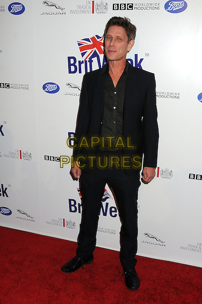 Jamie Harris.BritWeek 2012 Official Launch held at a Private Residence, Los Angeles, California, USA..April 24th, 2012.full length black suit shirt   .CAP/ADM/BP.©Byron Purvis/AdMedia/Capital Pictures.