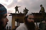 Settlers and soldiers during the demolition of a synagogue, in the unauthorized Israeli outpost of Tapuach West, in the West Bank. The synagogue was built in memory of the late Rabbi Meir Kahana, past-leader of the extreme Jewish rightwing, and is being demolished as part of the steps Israel takes against illegal outposts.
