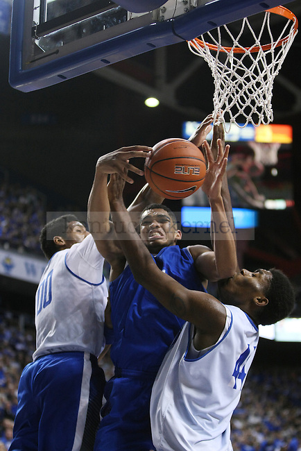 Karl-Anthony Towns goes to shoot the ball during the Blue and White Scrimmage in Rupp Arena in Lexington, Ky., on Monday, October 27,  2014. Photo by Emily Wuetcher | Staff