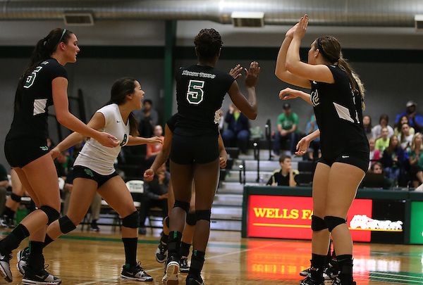 Denton, TX - November 3: Analisse Shannon #15, Shelby Tamura #8 and Amy Henard #12 of the University of North Texas Mean Green volleyball against  Tulane University at University of North Texas Volleyball Complex in Denton on November 3,, 2013 in Denton, Texas. (Photo by Rick Yeatts)
