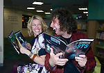 """Welsh musicians Cerys Matthews (Ex Catatonia) and Stuart Cable (Ex Stereophonics) getting ready for Halloween by reading kids books on Aliens and Ghosts inside Swansea Central Library today, to help publicise the """"Happy Days"""" campaign which demonstrates how libraries can make you happy. .The campaign is running all over Wales.."""
