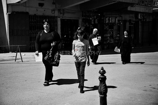 4.4..2015, Kirkuk,Iraq:  Marta and her mother going back home after attended the Easter ceremony
