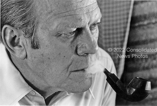 United States President Gerald R. Ford puffs on his pipe at the White House in Washington, D.C. on May 20, 1975. <br /> Mandatory Credit: David Hume Kennerly / White House via CNP
