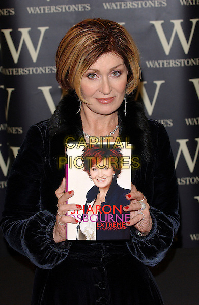"SHARON OSBOURNE .Signs Copies of her autobiography ""Extreme"" at Waterstones, Oxford Street, London, UK..December 9th, 2005.Ref: BEL.half length book nail polish varnish rings jewellery.www.capitalpictures.com.sales@capitalpictures.com.© Capital Pictures."
