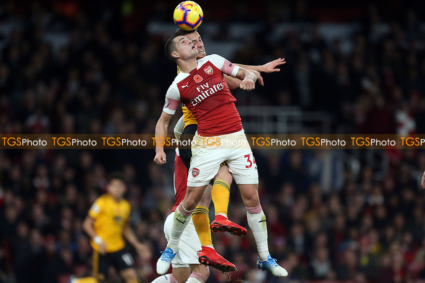 Diogo Jota of Wolves and Granit Xhaka of Arsenal during Arsenal vs Wolverhampton Wanderers, Premier League Football at the Emirates Stadium on 11th November 2018