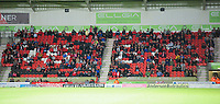 Lincoln City fans watch their team in action<br /> <br /> Photographer Andrew Vaughan/CameraSport<br /> <br /> EFL Leasing.com Trophy - Northern Section - Group H - Doncaster Rovers v Lincoln City - Tuesday 3rd September 2019 - Keepmoat Stadium - Doncaster<br />  <br /> World Copyright © 2018 CameraSport. All rights reserved. 43 Linden Ave. Countesthorpe. Leicester. England. LE8 5PG - Tel: +44 (0) 116 277 4147 - admin@camerasport.com - www.camerasport.com