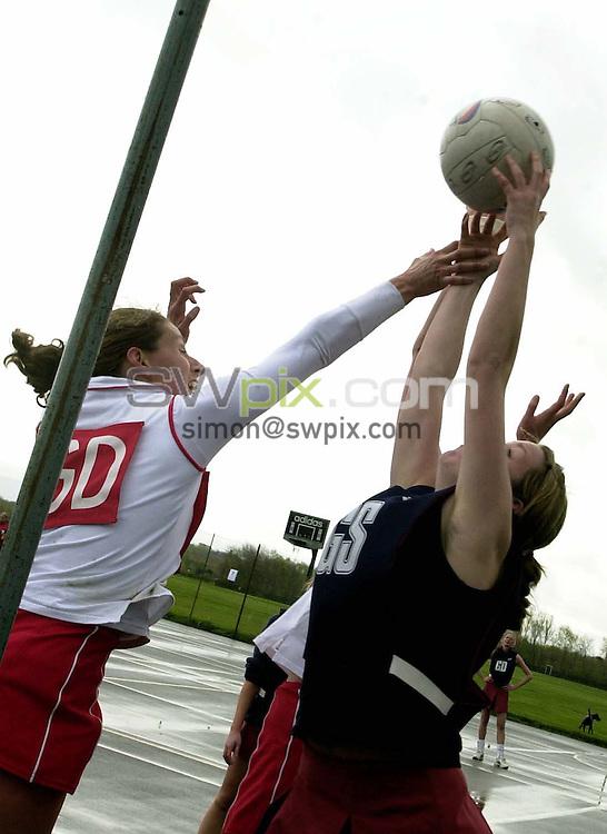 Pix: Simon Wilkinson/SWpix.com. Netball. Senior Open Inter Counties Tournament 2004. Acklam Sports Centre 18/04/04...COPYRIGHT PICTURE>>SIMON WILKINSON>>01943 608782>>.. Staffordshire and Devon East  generic netball
