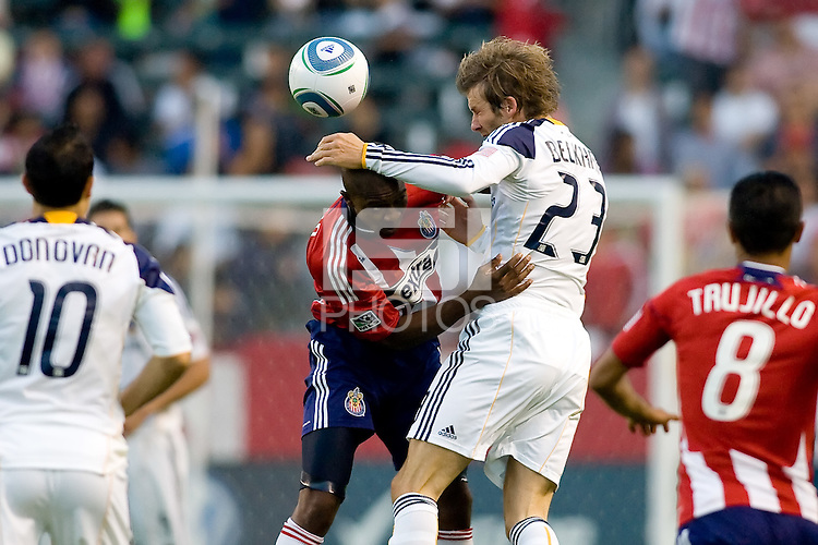 LA Galaxy midfielder David Beckham heads a ball past Chivas USA midfielder Michael Lahoud. The LA Galaxy beat Chivas USA 2-1 at Home Depot Center stadium in Carson, California on Sunday October 3, 2010.
