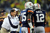Jan 10, 2011; Glendale, AZ, USA; Auburn Tigers head coach Gene Chizik reacts after his defense stopped the Oregon Ducks on fourth and goal during the third quarter of the 2011 BCS National Championship game at University of Phoenix Stadium.  Mandatory Credit: Mark J. Rebilas-