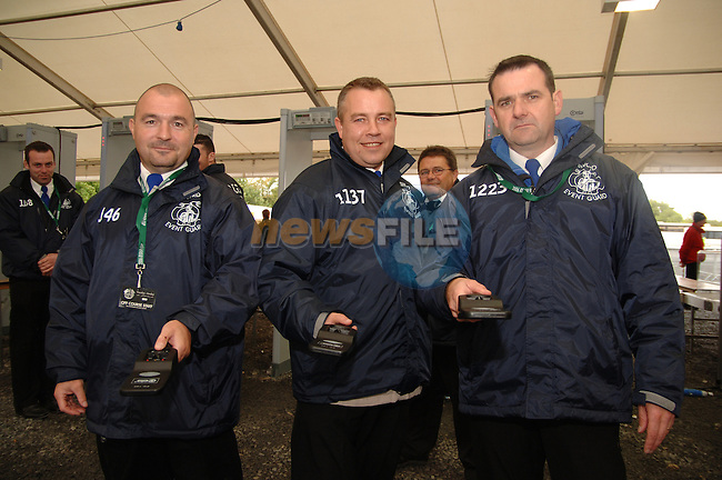 20th September, 2006. Dublin Ireland. Crowds attend the second practise day of the 2006 Ryder Cup at the K Club. From L to R: Michael 'Tommy' Sutcliffe, Mick Brannigan, Malachy McCall on security duty at the above..Photo: Barry Cronin/ Newsfile.