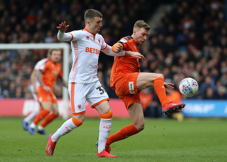 Blackpool's Chris Long battles with Luton Town's Jack Stacey<br /> <br /> Photographer David Shipman/CameraSport<br /> <br /> The EFL Sky Bet League One - Luton Town v Blackpool - Saturday 6th April 2019 - Kenilworth Road - Luton<br /> <br /> World Copyright © 2019 CameraSport. All rights reserved. 43 Linden Ave. Countesthorpe. Leicester. England. LE8 5PG - Tel: +44 (0) 116 277 4147 - admin@camerasport.com - www.camerasport.com