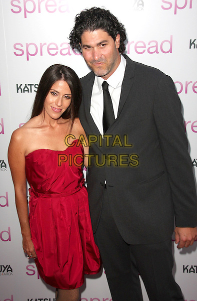 "SOLEIL MOON FRYE & JASON GOLDBERG.""Spread"" Los Angeles Premiere held at the ArcLight Hollywood, Hollywood, California, USA..August 3rd, 2009.half length red strapless dress black suit jacket married husband wife .CAP/ADM/CH.©Charles Harris/AdMedia/Capital Pictures"
