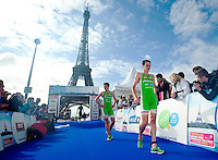09 JUL 2011 - PARIS, FRA - Alistair Brownlee (EC Sartrouville) leads brother Jonathan Brownlee (EC Sartrouville) from the finish line during the men's French Grand Prix series race .(PHOTO (C) NIGEL FARROW)